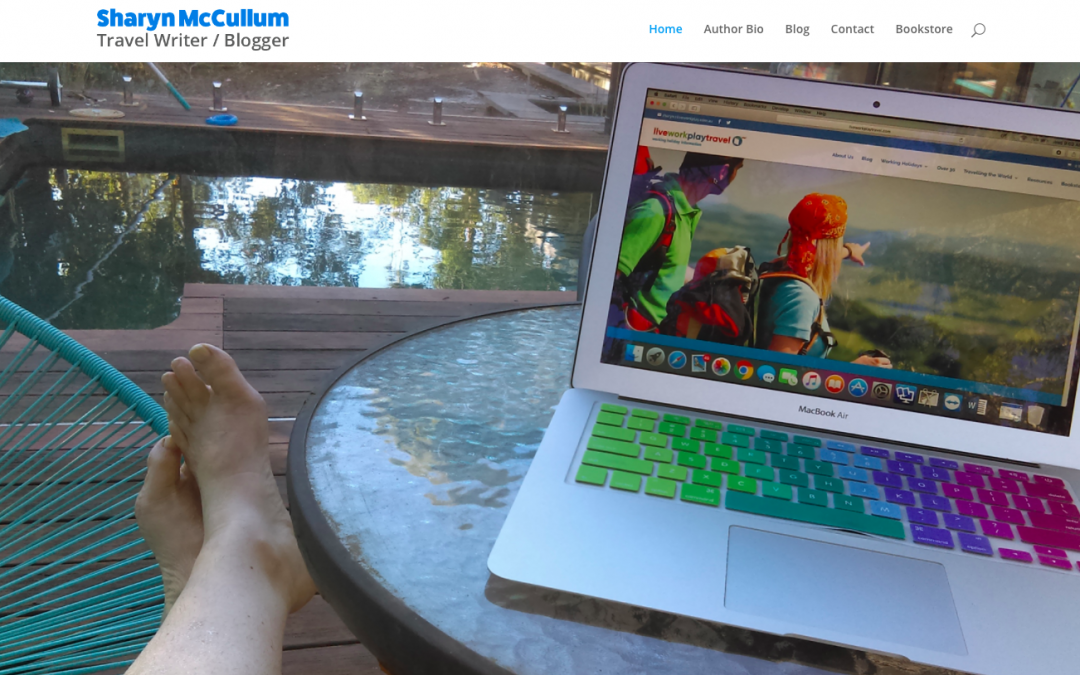 Live Work and Play Website Home Page with Sharyn McCullum sitting by her pool with her laptop.