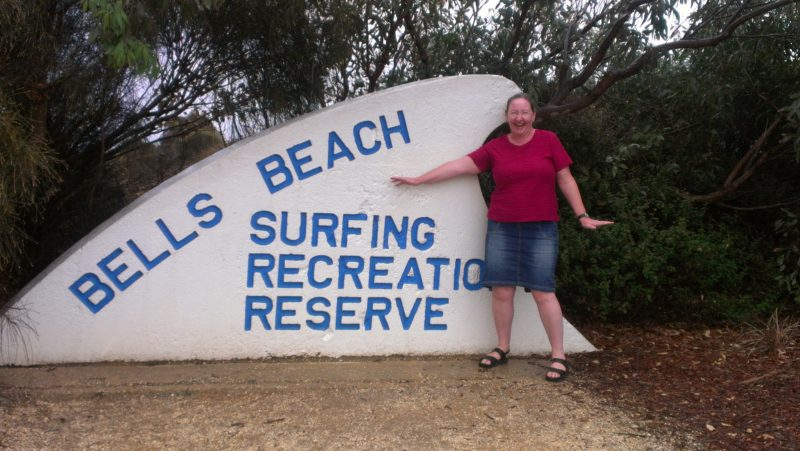 Bells Beach Surfing Recreation Reserve Sign shaped like a big white wave with Sharyn McCullum.