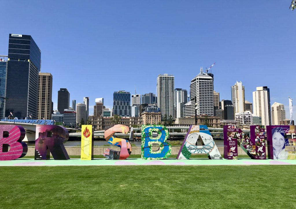 Brisbane Sign With Brisbane Buildings Behind Sign.