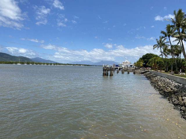 Cairns Foreshore. Boats Line The Cairns Foreshore With Mountains Behind.