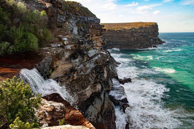 Royal National Park In Sydney Has A Coastal Track Along The Sheer Cliff Face. See Ocean Lapping The Cliffs As You Walk.