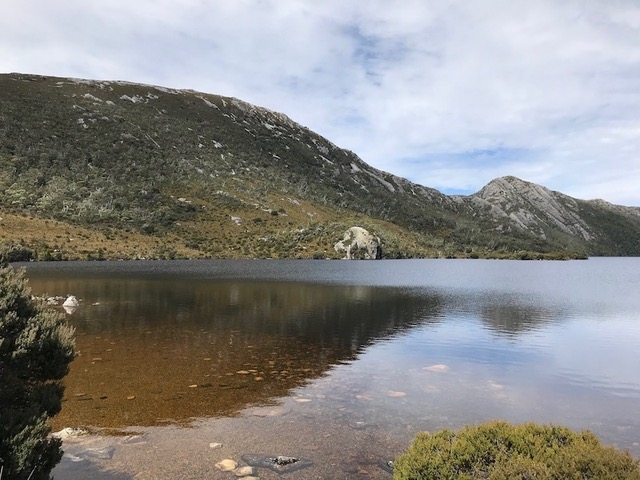 Dove Lake In Tasmania Is A Beautiful Lake Surrounded By Mountains.
