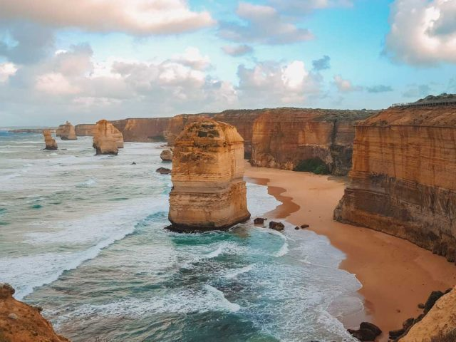 The 12 Apostles On The Great Ocean Road Were Created From Natures Elements Wearing Them Down. Golden Stone Outcrops Standing In The Ocean.