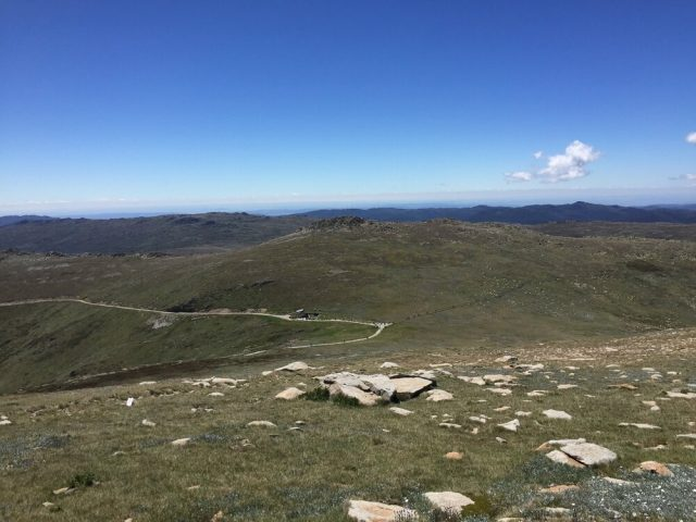 The Top Of Mount Kosciuszko Offers Spectacular Views Over The Snowy Mountains. During Summer When You Can Climb To The Summit The Flora Is Baron But Beautiful.