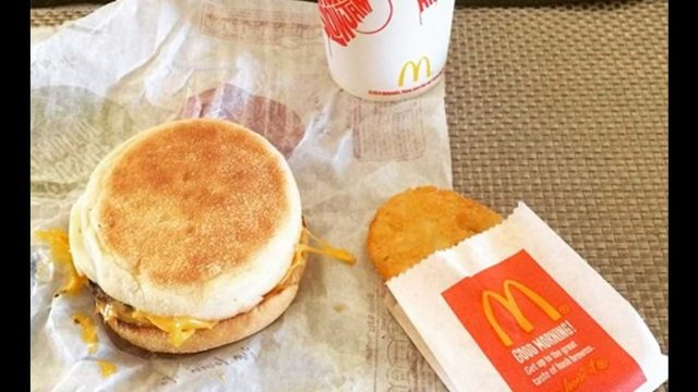 McDonalds Breakfast. Egg McMuffen With a Hash Brown And A Coffee