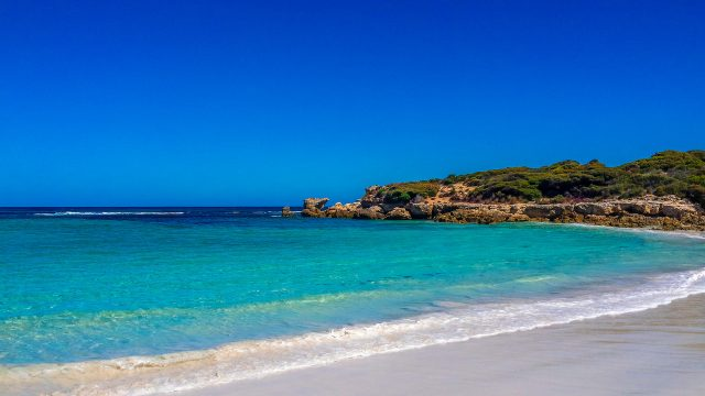 Hanson Bay On Kangaroo Island Is A Bay With White Sand Being Lapped By Aqua Ocean.