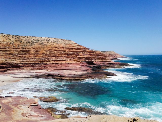 Kalbarri In Wa Has Many Rocky Outcrops With Small Bays With Sand Being Lapped By Aqua Ocean.