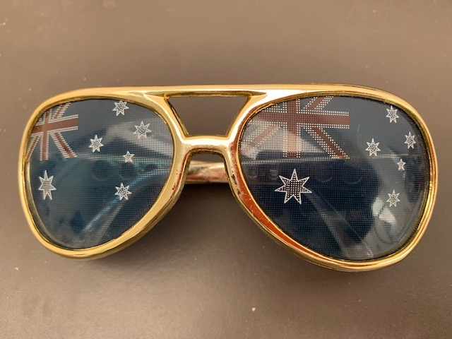 Pair Of Gold Rimmed Sunglasses With Australia Flag on Lenses.