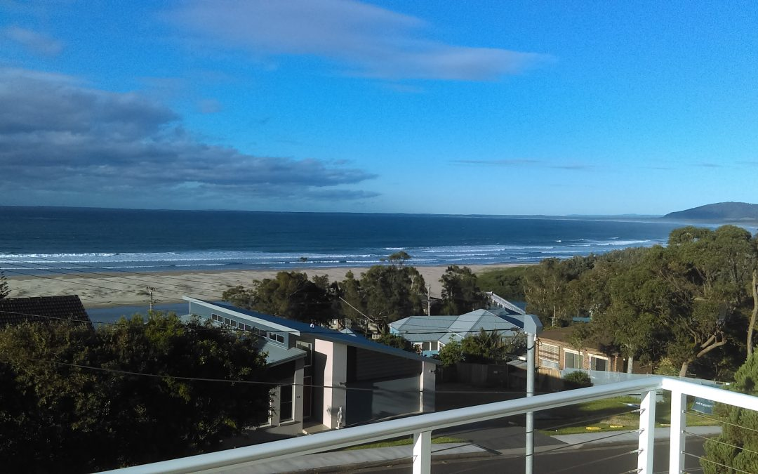 View Over Gerroa Beach With Deep Blue Ocean, Golden Sands and Blue Sky