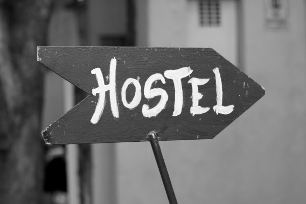 Hostel Sign Pointing To Hostel Jobs In Australia