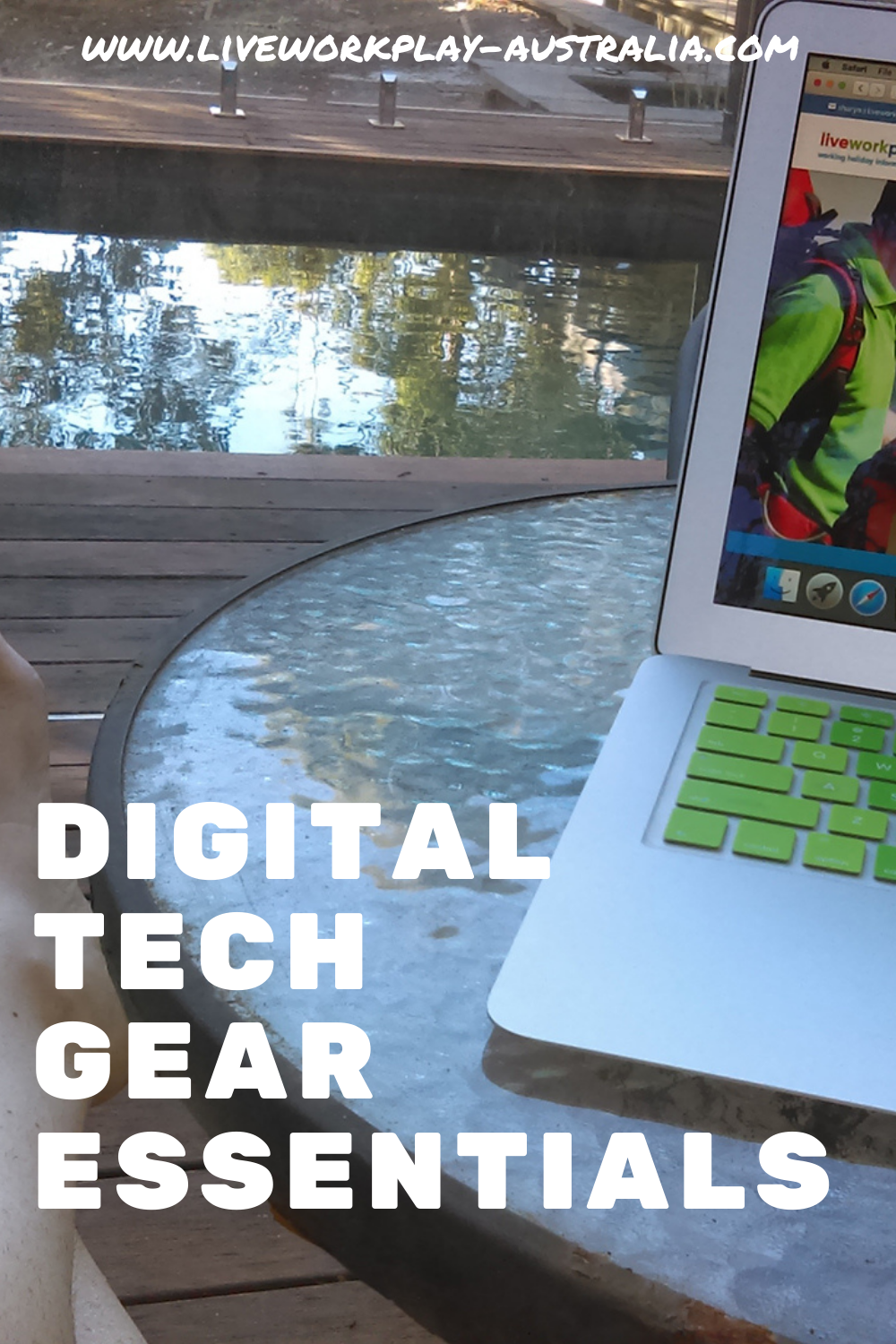 Tech Gear To Take Travelling. A Laptop On A Table By A Pool.