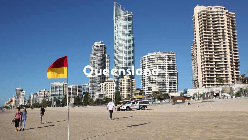 Golden Sandy Beach With Tall Buildings Along The Edge Of The Sand On The Gold Coast, Queensland.