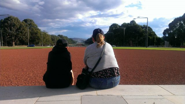 Sitting On Steps Of National War Memorial Canberra Looking Down To Parliament House.