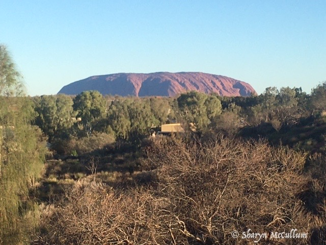 Uluru Changes Colour During The Day. Here It Is Dark Red.